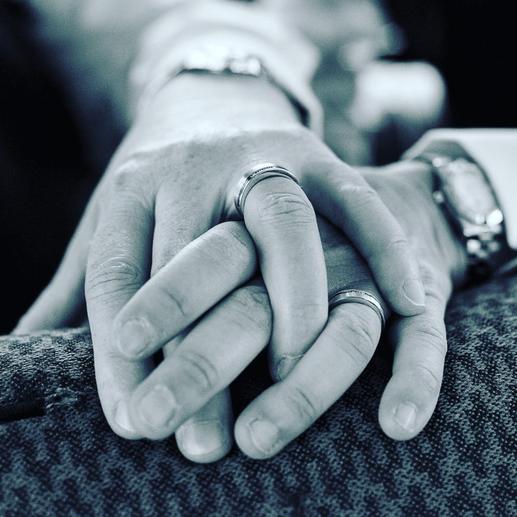 couple hands with rings
