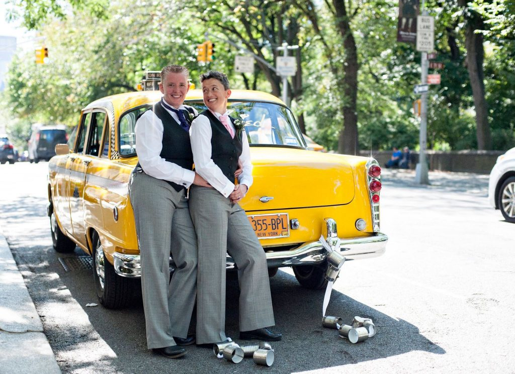 gay couple and yellow taxi myohmy weddings